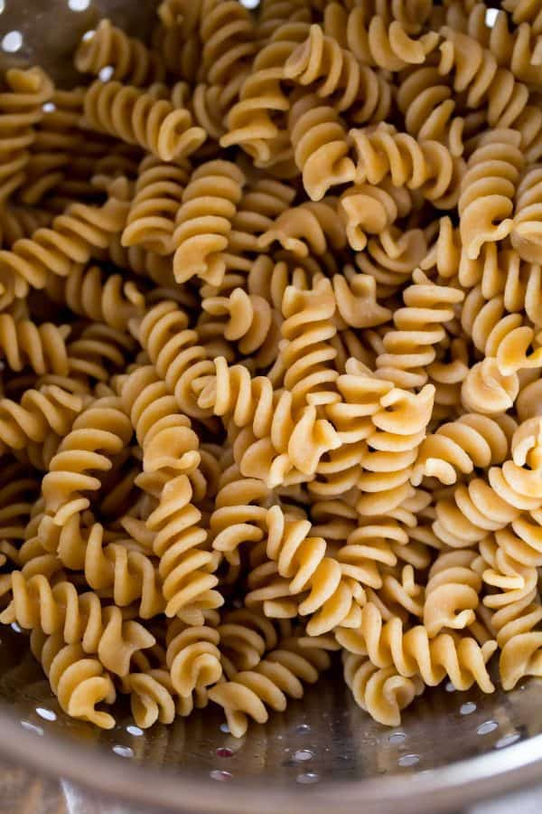 Cooked whole wheat pasta from DeLallo is the base of the chicken Caesar pasta salad.