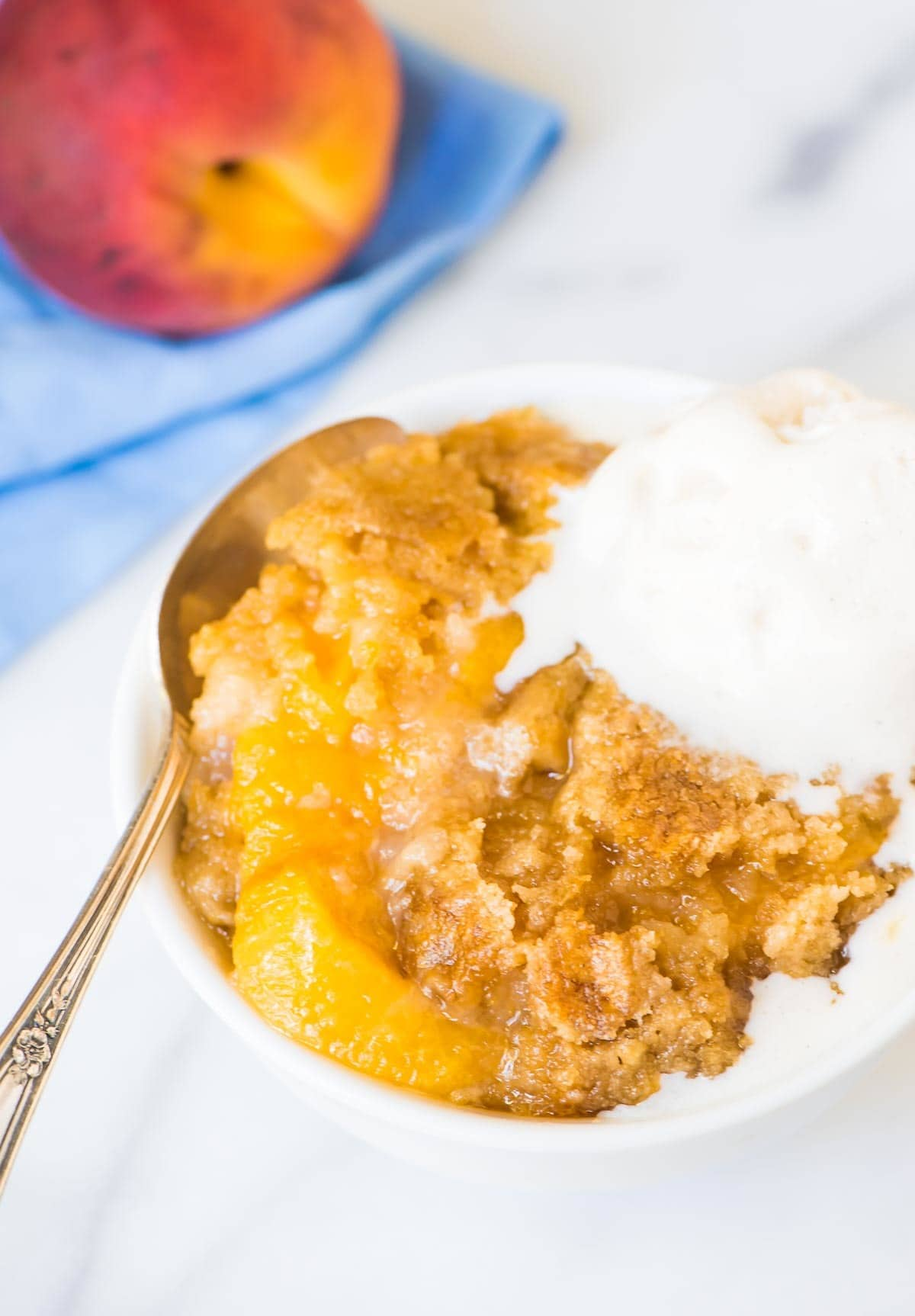 Crock Pot Peach Cobbler — This recipe is so EASY and it tastes amazing! Just dump the ingredients into your slow cooker and walk away. Tastes like a peach dump dessert, but so much better — made with real ingredients and fresh peaches instead of boxed cake mix or canned. @wellplated