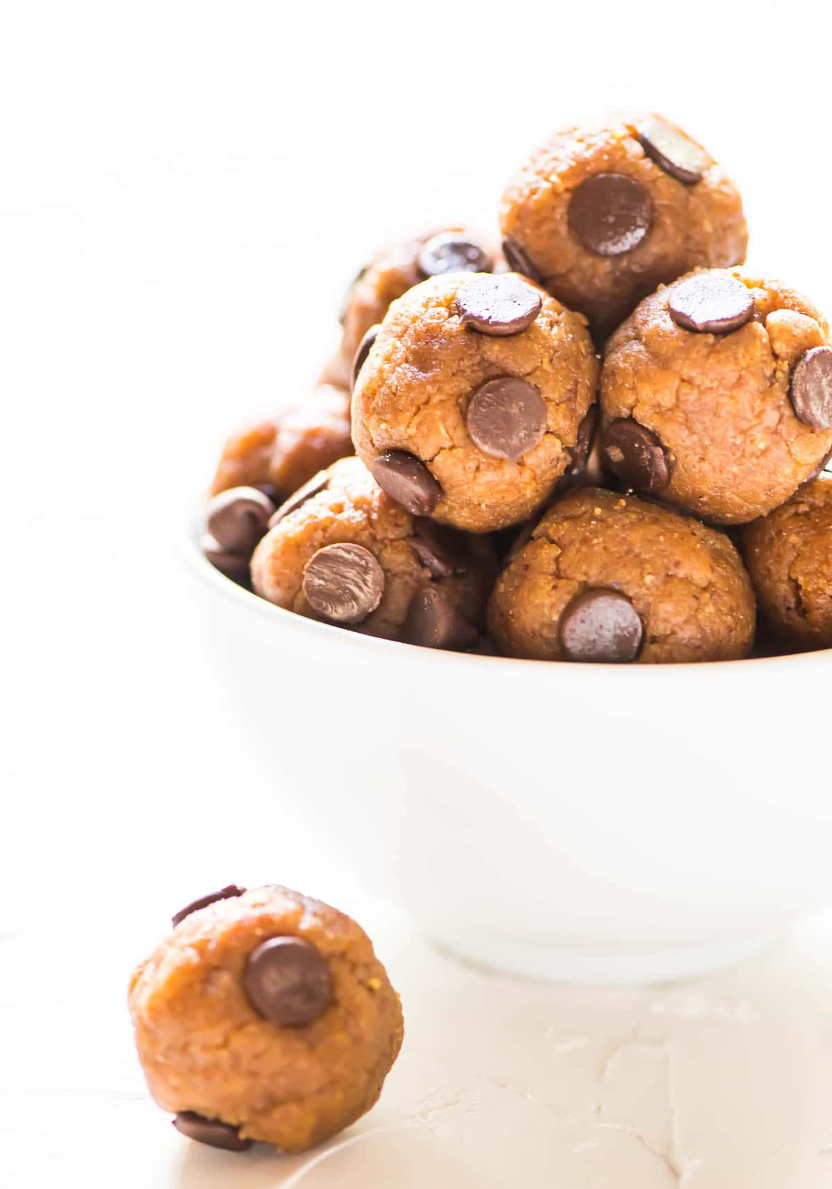 white bowl filled with No Bake Cookie Dough Protein Balls