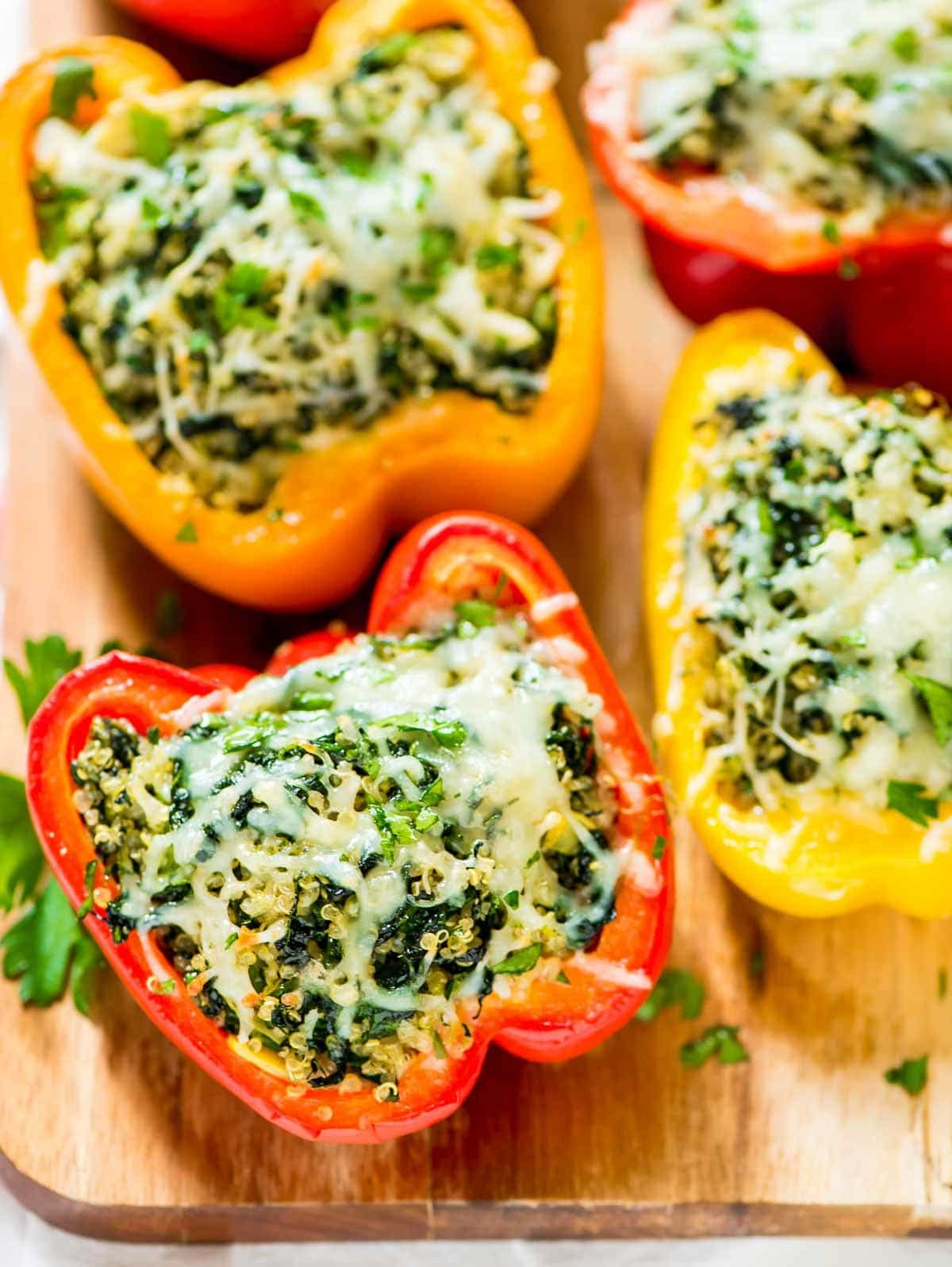 Spinach Artichoke Quinoa Stuffed Bell Peppers – An easy and healthy recipe. We can't get enough! @wellplated
