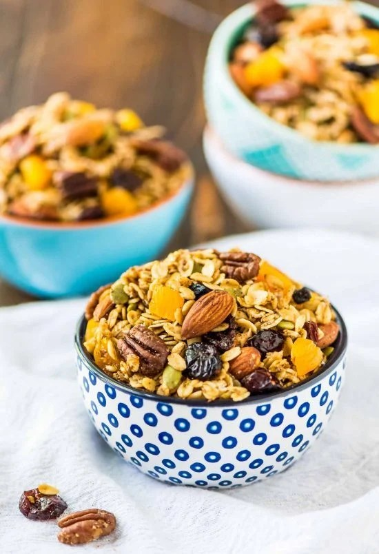 bowls of healthy granola made in a slow cooker