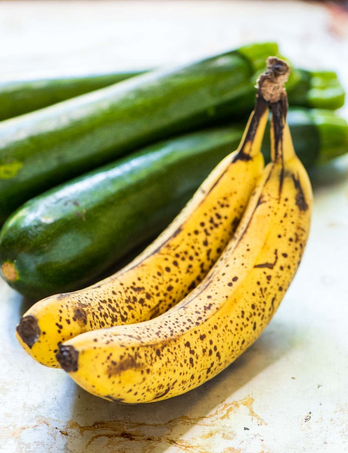 2 speckled ripe bananas and 3 whole zucchini