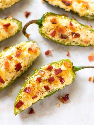 If you like spicy, you will LOVE these Bacon Jalapeno Poppers! Halved jalapeños stuffed with cream cheese, shredded cheese, bacon, and garlic, topped with crispy bread crumbs, then baked to golden perfection. @wellplated