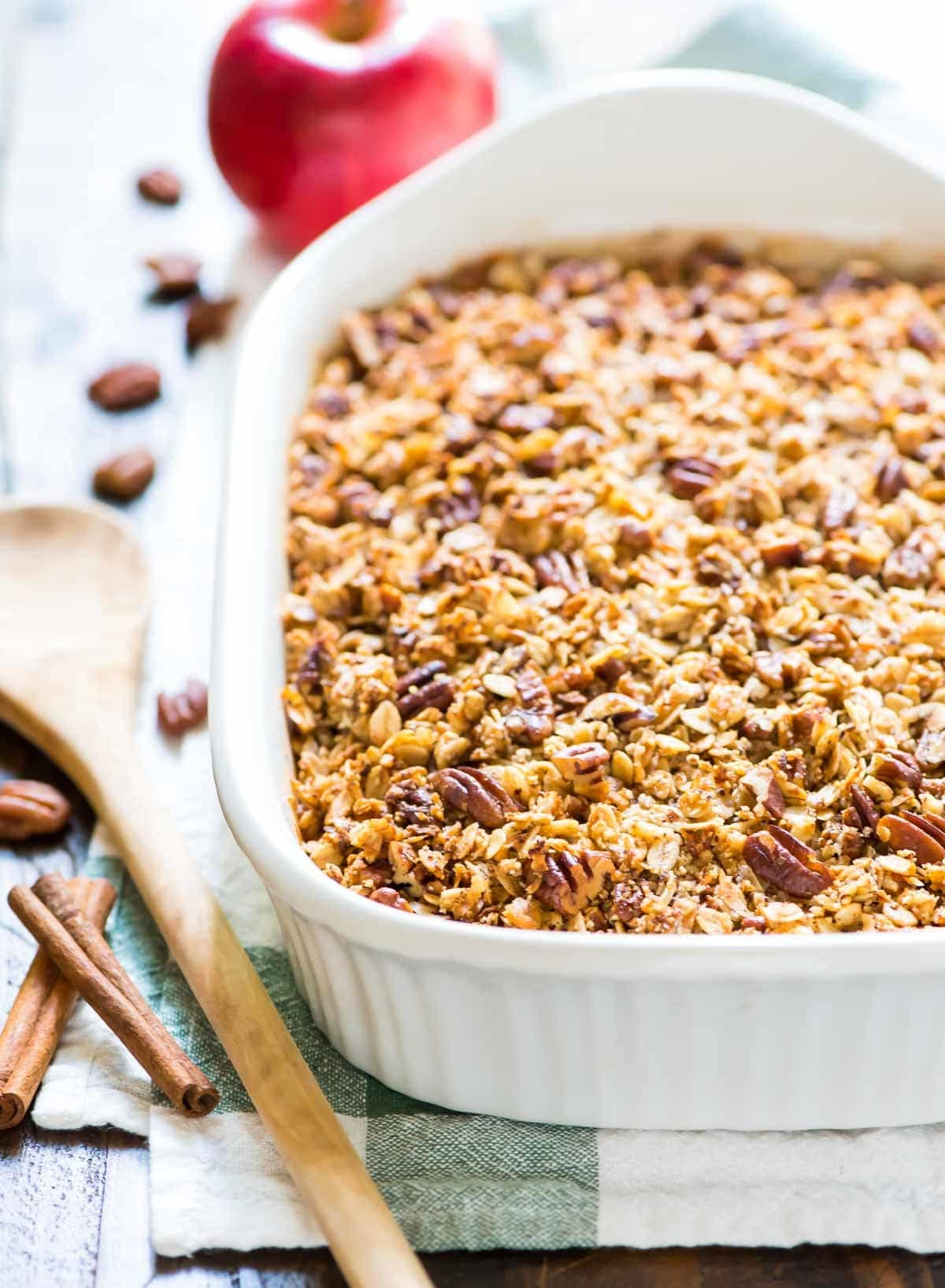 Vegan Apple Crisp with the BEST Pecan Oat Topping. Easy, healthy, and gluten free! This recipe is made with coconut oil and maple syrup, so it's clean eating approved. @wellplated