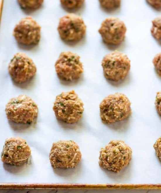 healthy turkey meatballs, perfectly uniform in size, ready for baking in the oven
