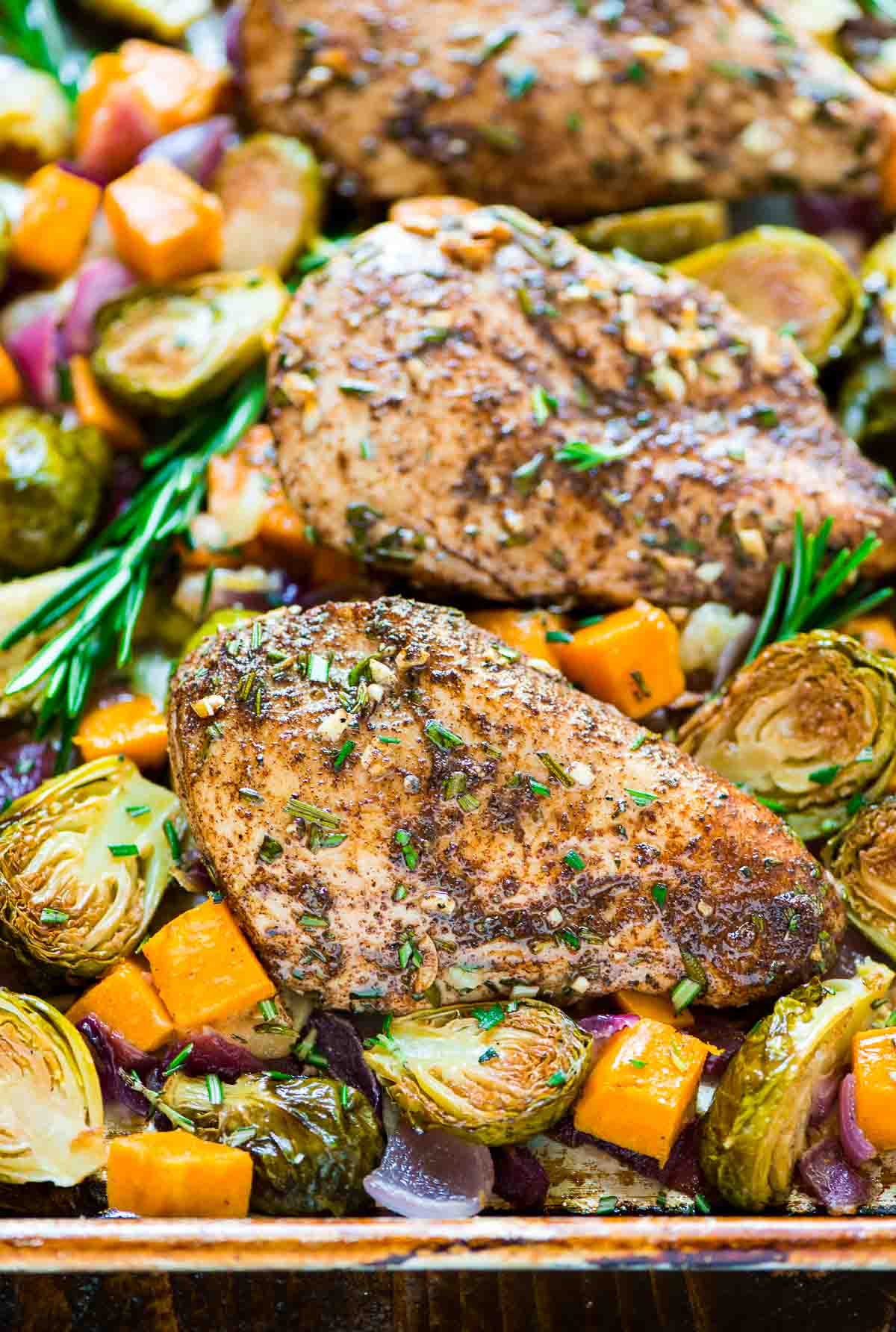 ONE PAN Paleo Harvest Chicken Dinner with Apples, Sweet Potatoes, and Brussels Sprouts. Easy and healthy sheet pan recipe that's perfect for busy weeknights. {Paleo, Gluten Free, and Dairy Free!} @wellplated