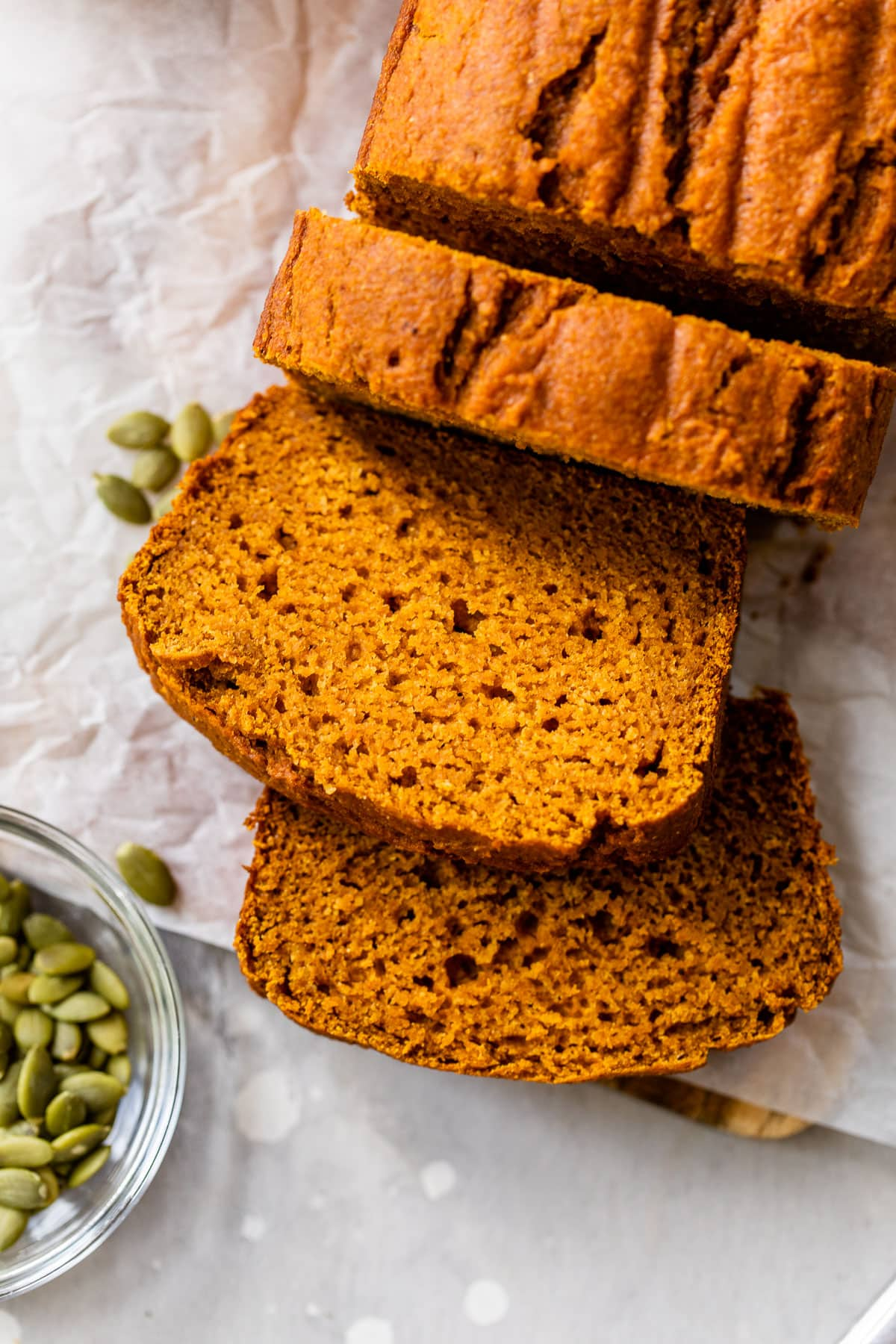 close up image of thick slices of healthy pumpkin bread