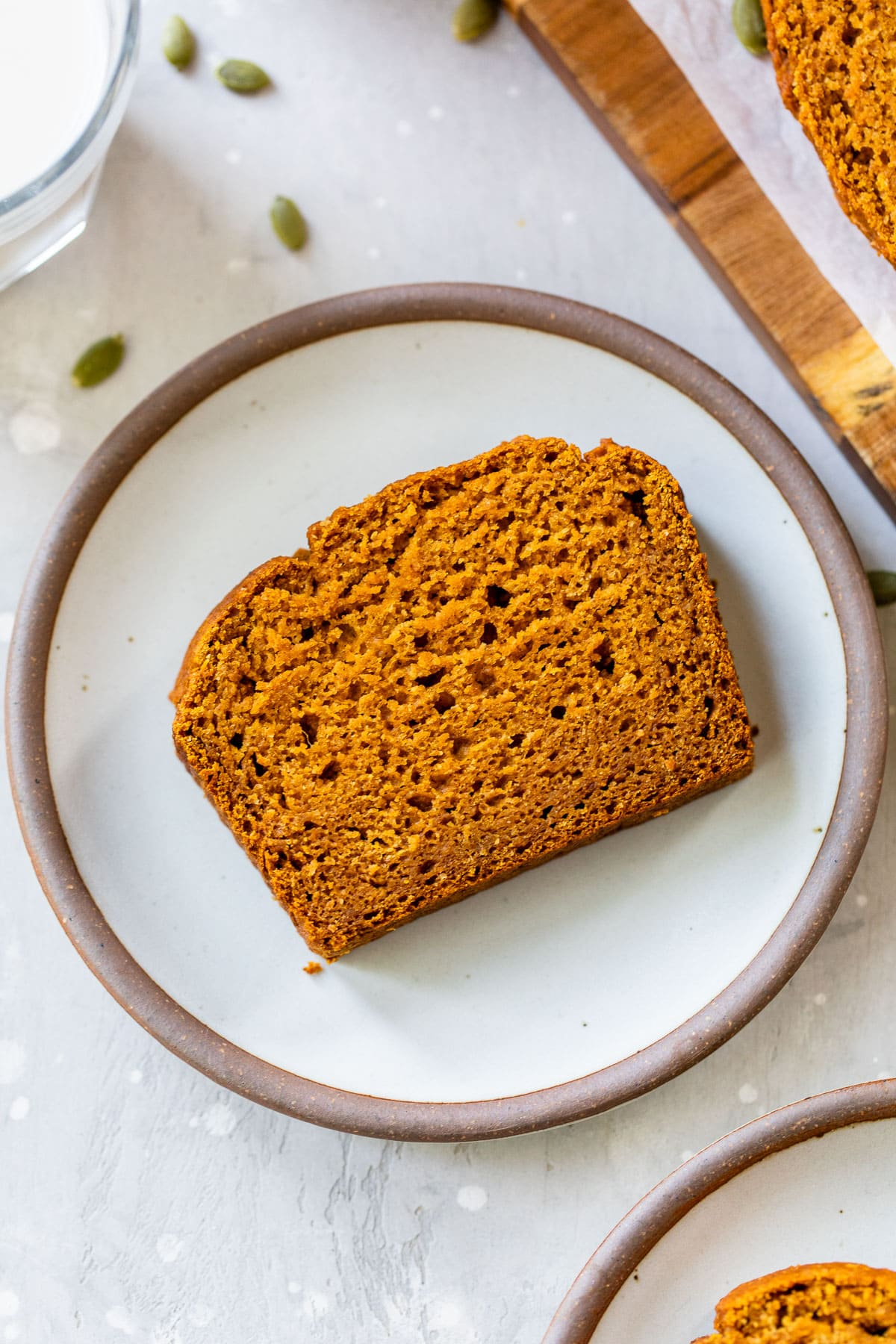 a loaf of healthy pumpkin bread made with no butter or sugar sitting on a cooling rack