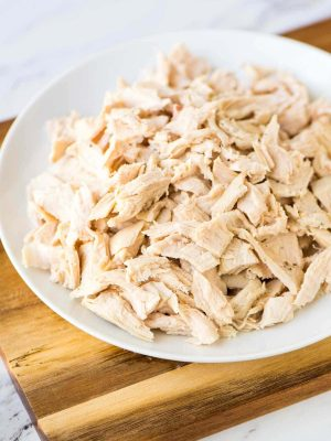 plate of poached and shredded chicken