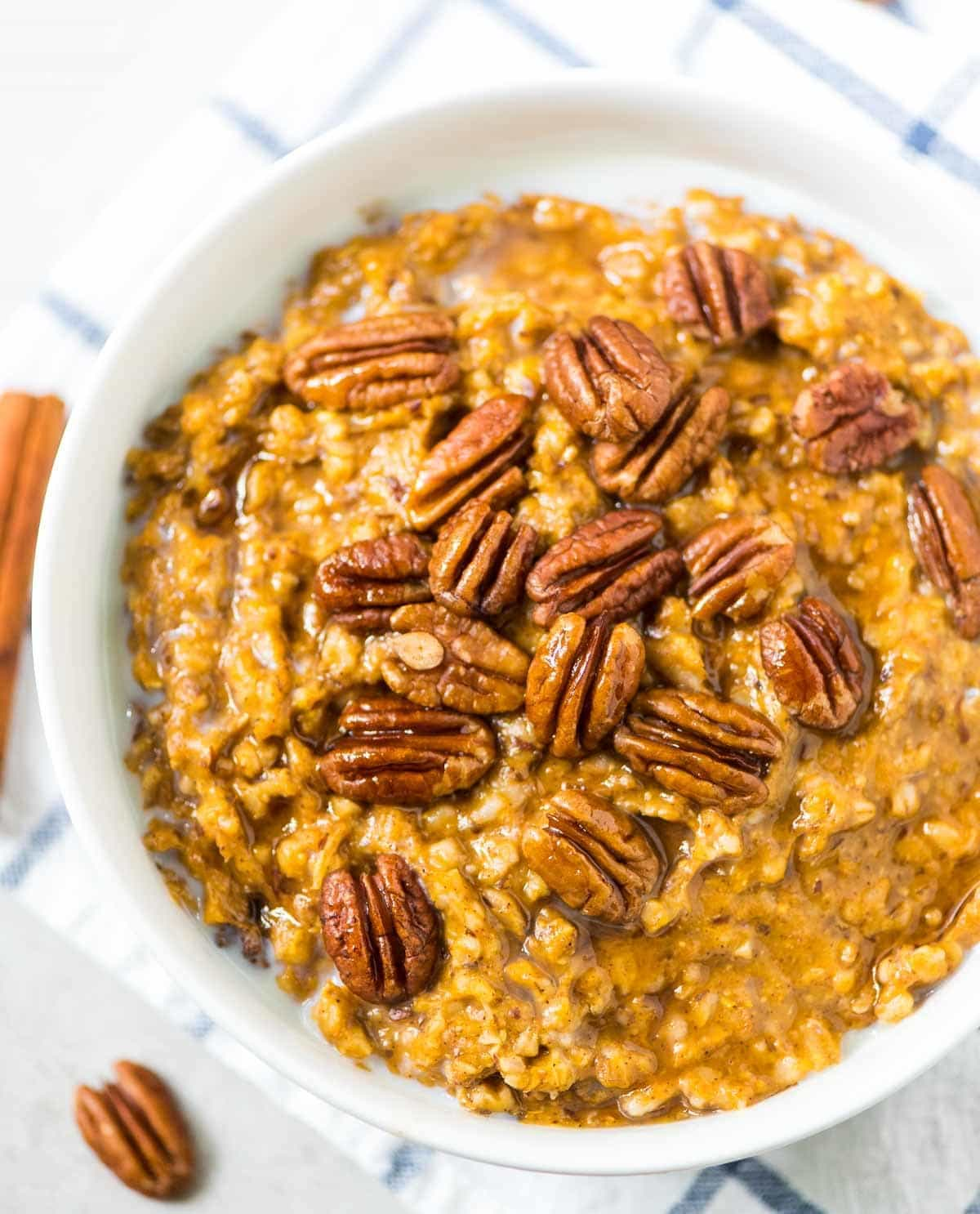 Pumpkin Overnight Oats ~ healthy crock pot steel cut oats made with warm spices, pumpkin and maple syrup. This recipe is easy to throw in the slow cooker before bed for an effortless breakfast that can last all week or feed a crowd! @wellplated
