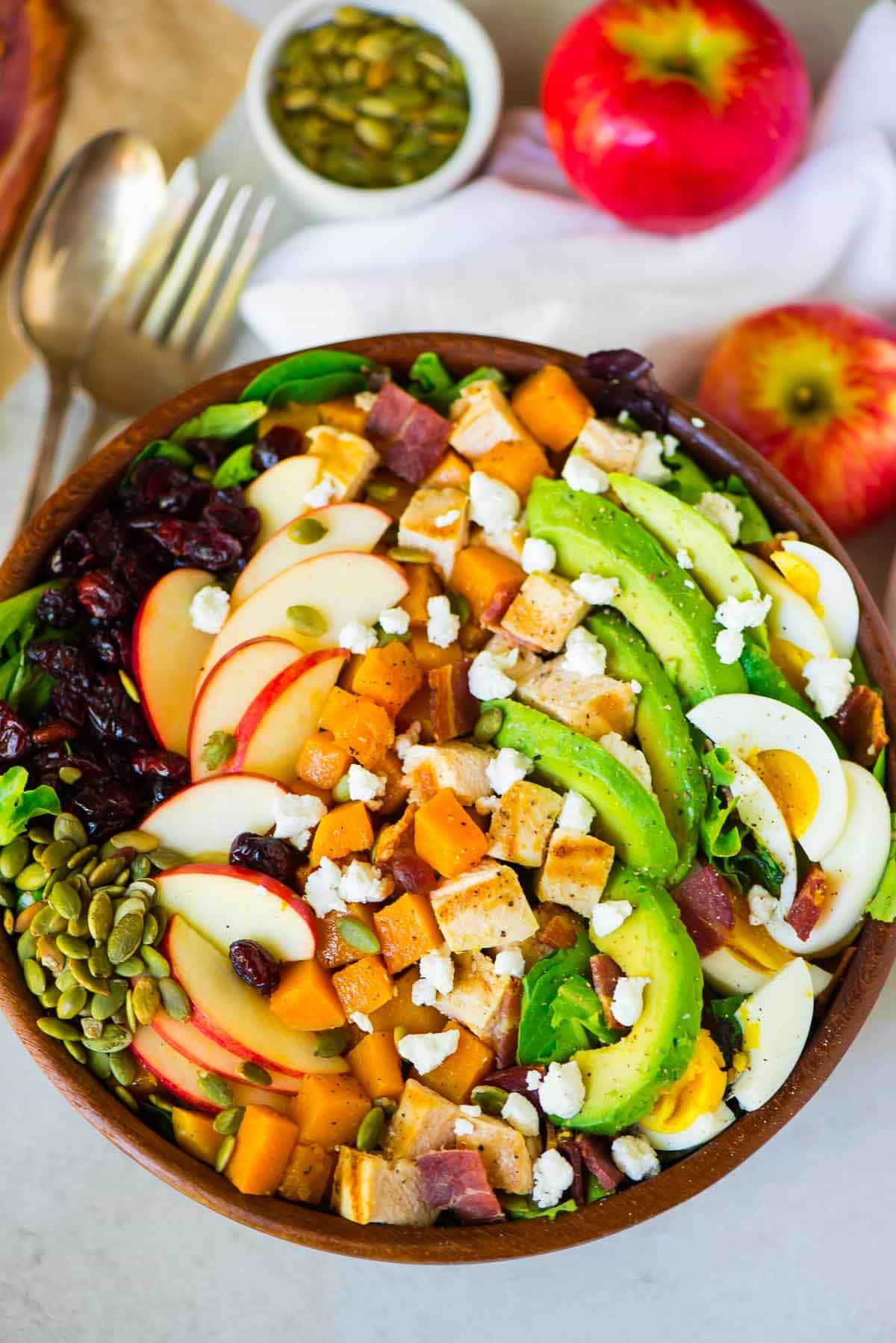 Butternut Squash Cobb Salad with Apples, Cranberries, and Goat Cheese. The BEST fall salad recipe for a main dish salad, Thanksgiving side dish, or holiday part. Recipe at wellplated.com | @wellplated