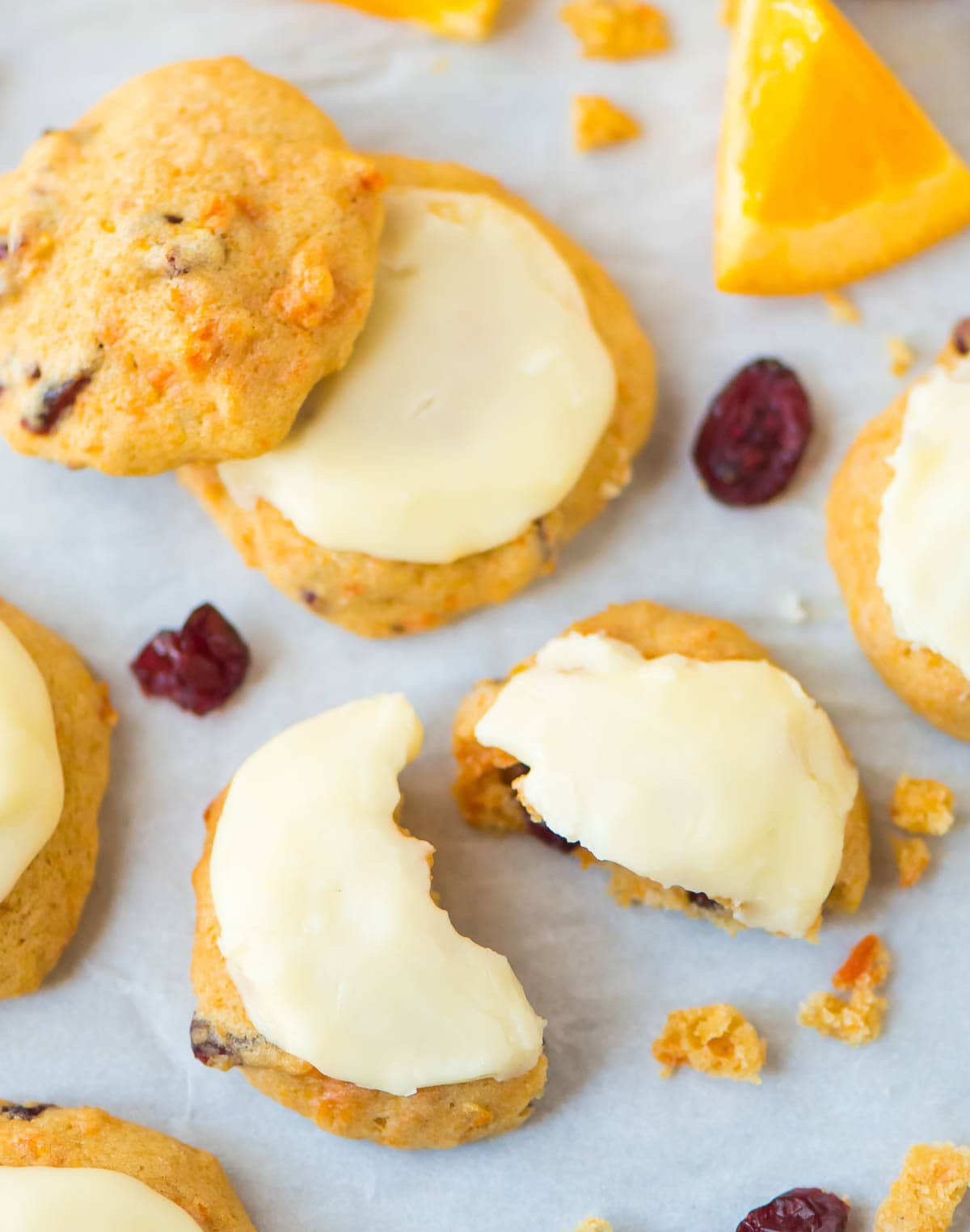 Melt in Your Mouth Cranberry Orange Cookies. Soft, citrusy, and frosted with creamy orange icing. Easy drop cookies you are going to love! Recipe at wellplated.com | @wellplated