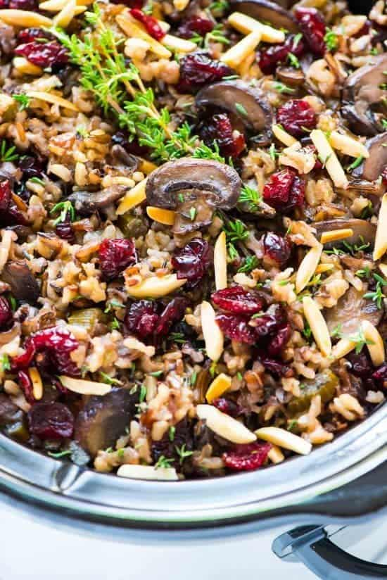 slow cooker full of gluten free wild rice stuffing with cranberries