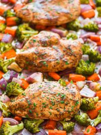 Maple Dijon Chicken and Vegetables. An easy, healthy dinner recipe that bakes on a single sheet pan for easy clean up! The chicken is juicy and tender and the maple Dijon glaze is absolutely delicious. Recipe at wellplated.com | @wellplated