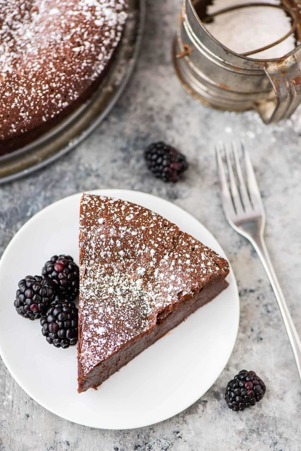 Rich and decadent Flourless Chocolate Torte. Easy to make and absolutely decadent! {gluten free and grain free} Recipe at wellplated.com | @wellplated