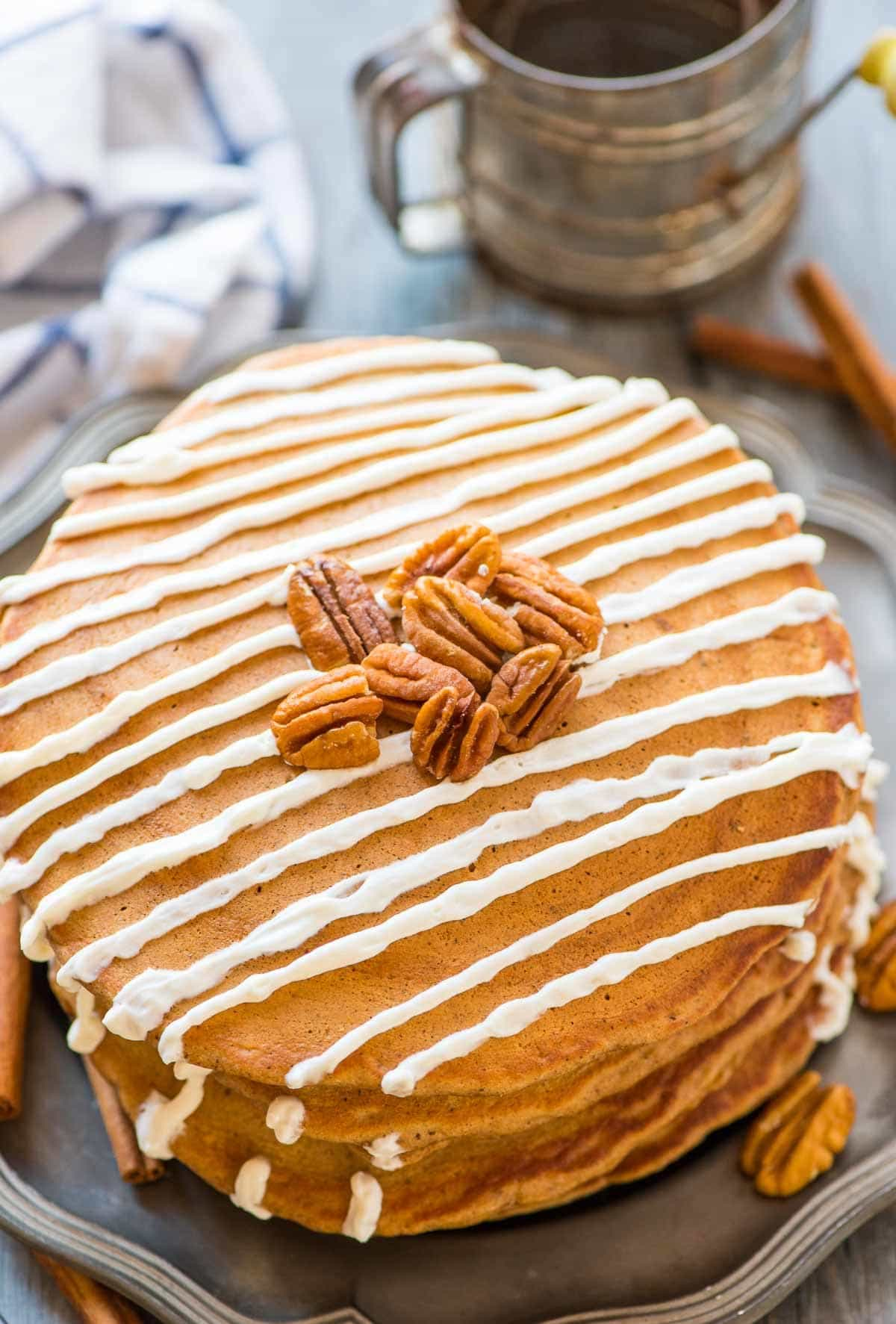 Soft and fluffy Gingerbread Pancakes with Maple Cream Cheese Topping. These Healthy Gingerbread Pancakes are made without molasses, so they are extra light and fluffy. Perfect for Christmas morning and holiday breakfasts! Recipe at wellplated.com | @wellplated