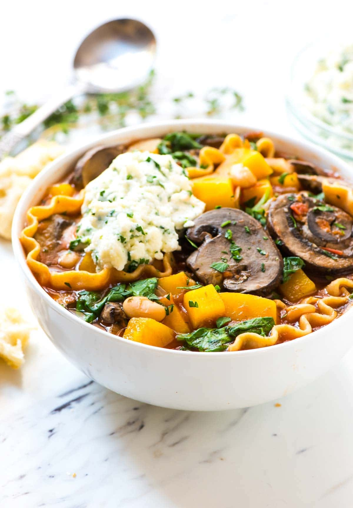 Slow Cooker Vegetarian Lasagna Soup. DELICIOUS and so much easier than regular lasagna! Healthy crockpot lasagna soup recipe with whole wheat pasta, butternut squash, and white beans. Recipe at wellplated.com | @wellplated