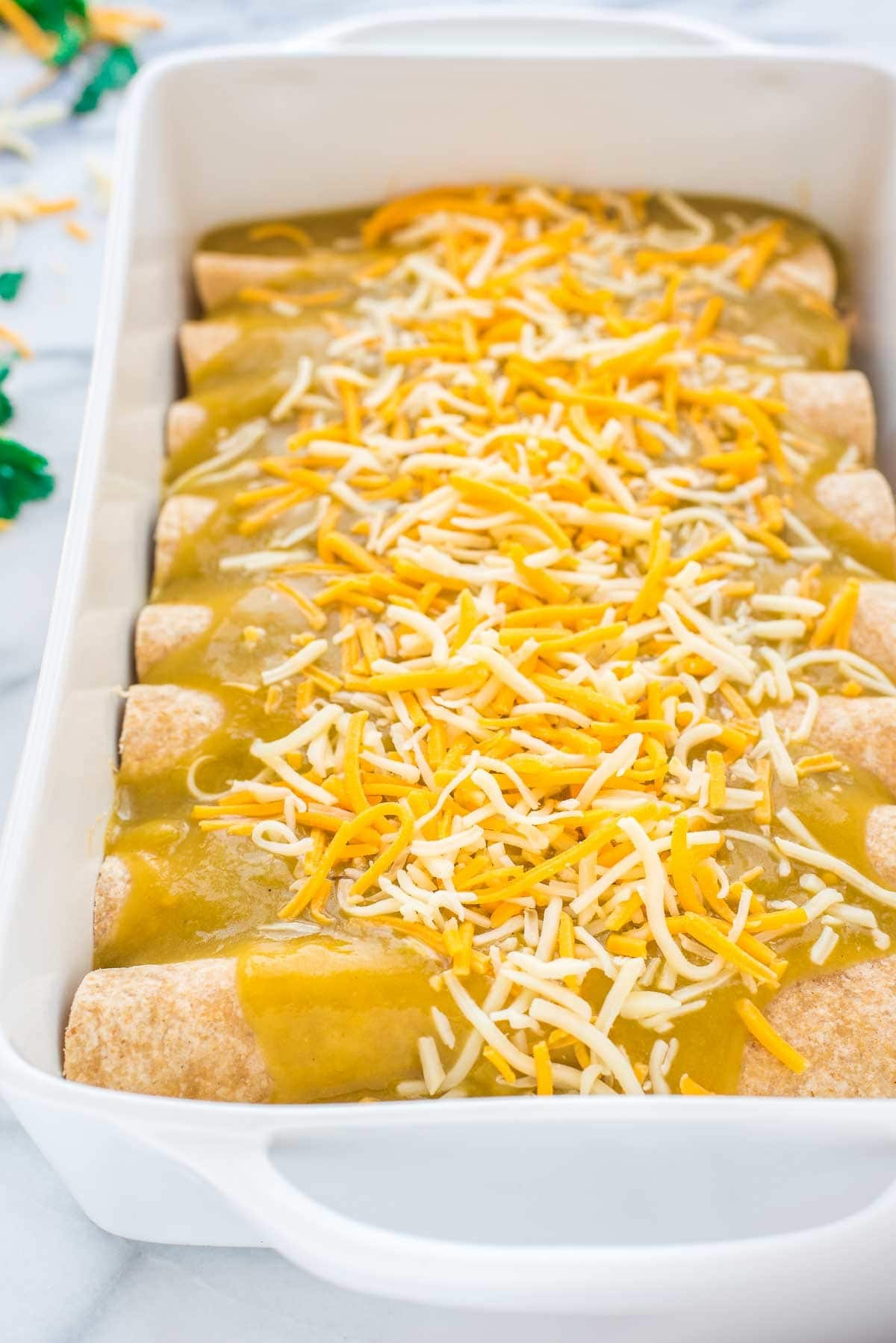 Chile Verde Chicken Enchiladas. Easy, creamy, and delicious! Recipe at wellplated.com | @wellplated