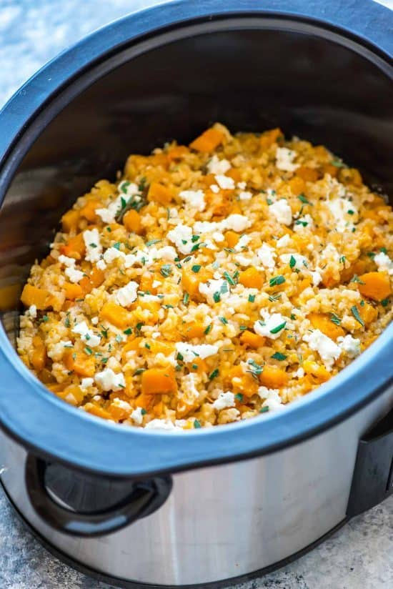crock pot full of brown rice risotto with butternut squash