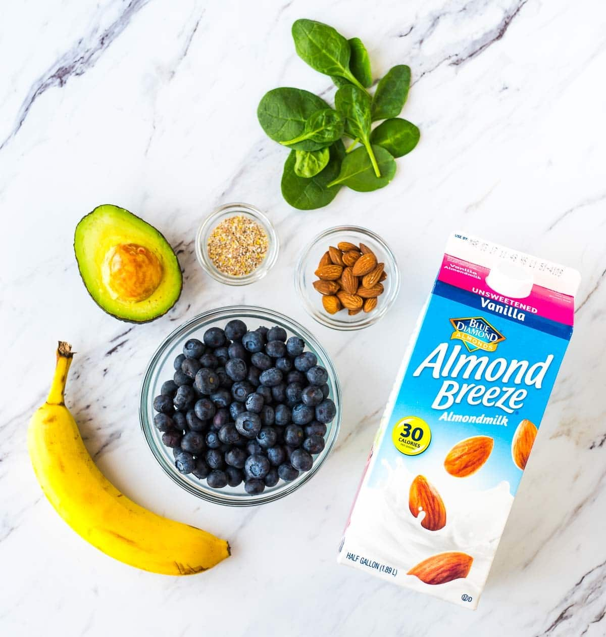 Ingredients to make a hydrating blueberry banana avocado smoothie recipe