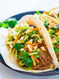 Asian pulled pork tacos made in a crock pot