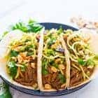 a plate of crock pot asian pulled pork tacos