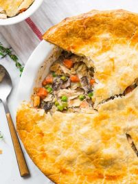 Healthy Chicken Pot Pie. Just 335 calories for a huge, creamy serving! Packed with juicy chicken, fresh veggies, and topped with a golden, flakey crust. An easy, comforting weeknight dinner! {dairy free; clean eating} Recipe at wellplated.com | @wellplated