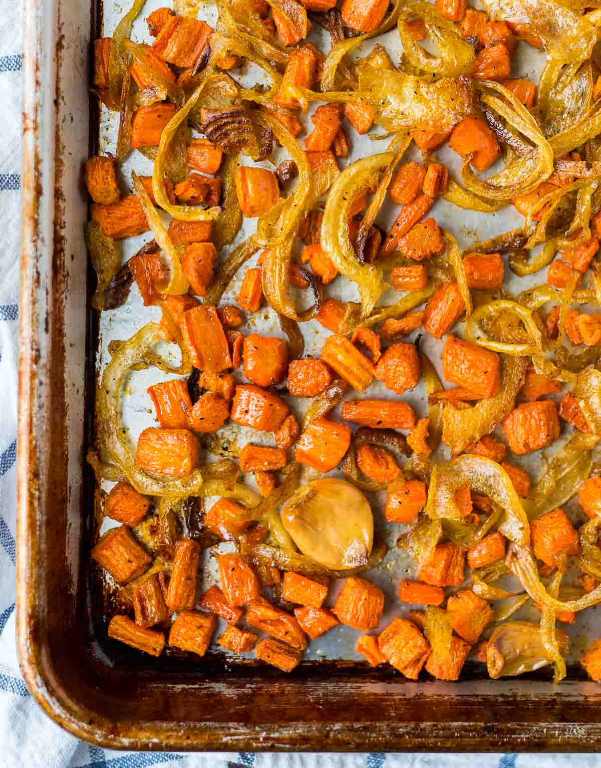 sheet pan with roasted carrots, onions, and garlic