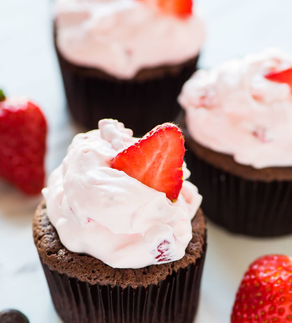Chocolate Mousse Cupcakes. Rich, silky, chocolate cupcakes, topped with fluffy Strawberry Cream Cheese Frosting. TO DIE FOR! Recipe at wellplated.com | @wellplated