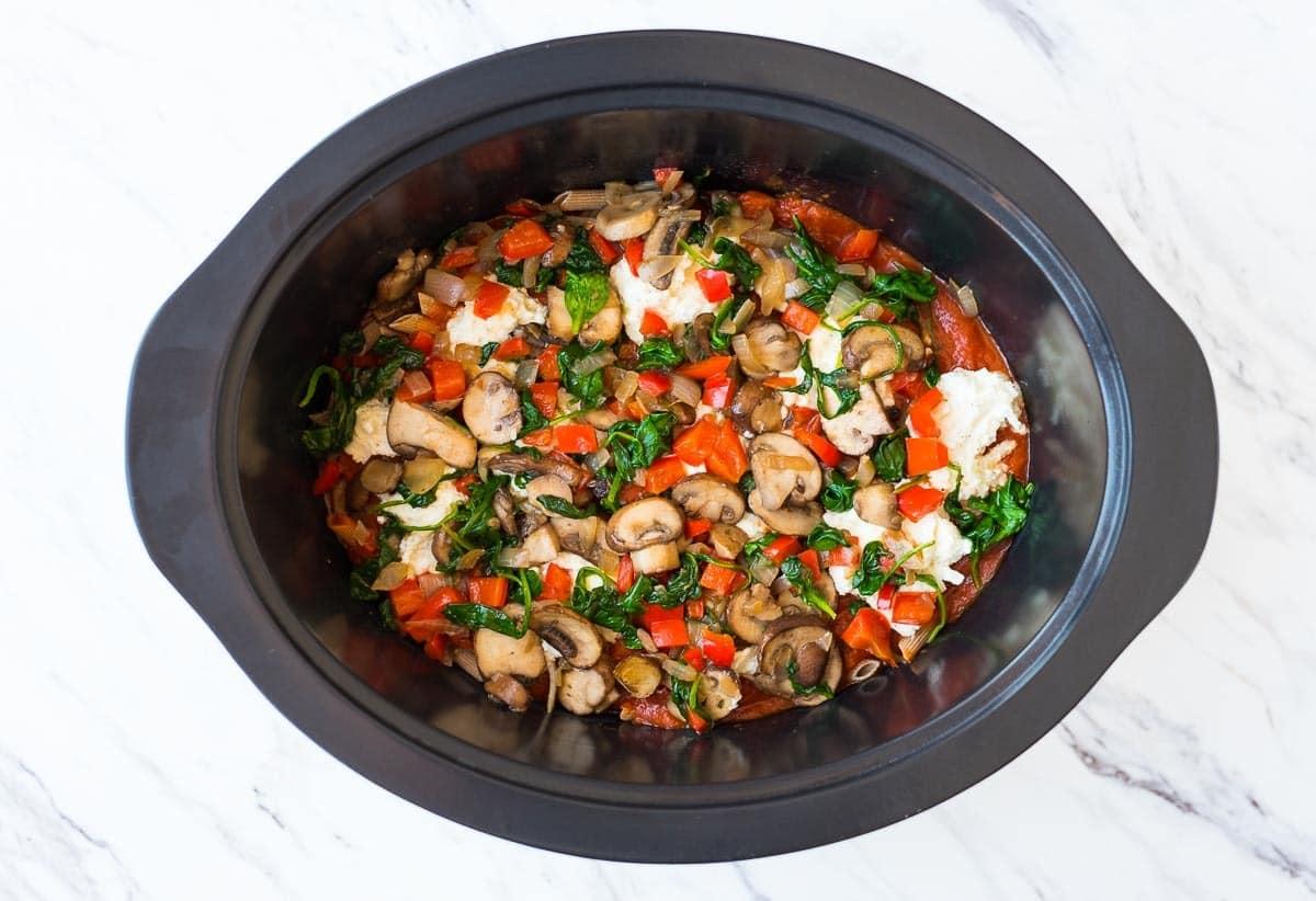 Slow cooker full of fresh vegetables to make healthy vegetarian crock pot pasta