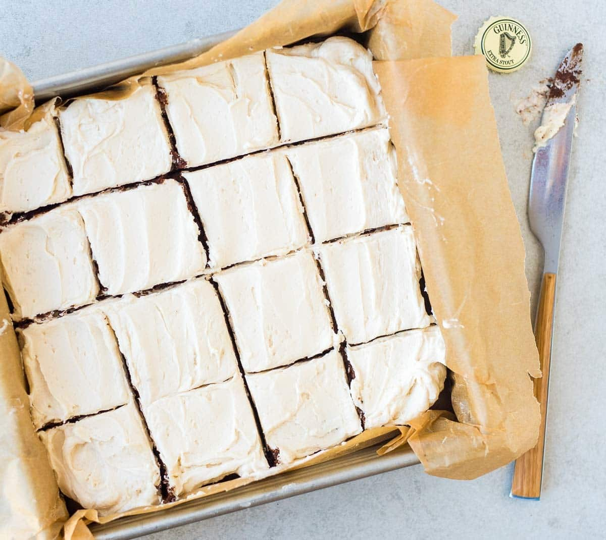 Guinness Brownies – Super moist and chewy brownies made with a hint of beer and topped with Guinness frosting. If you've like fudgy brownies, you will LOVE this stout brownie recipe! Recipe at wellplated.com | @wellplated