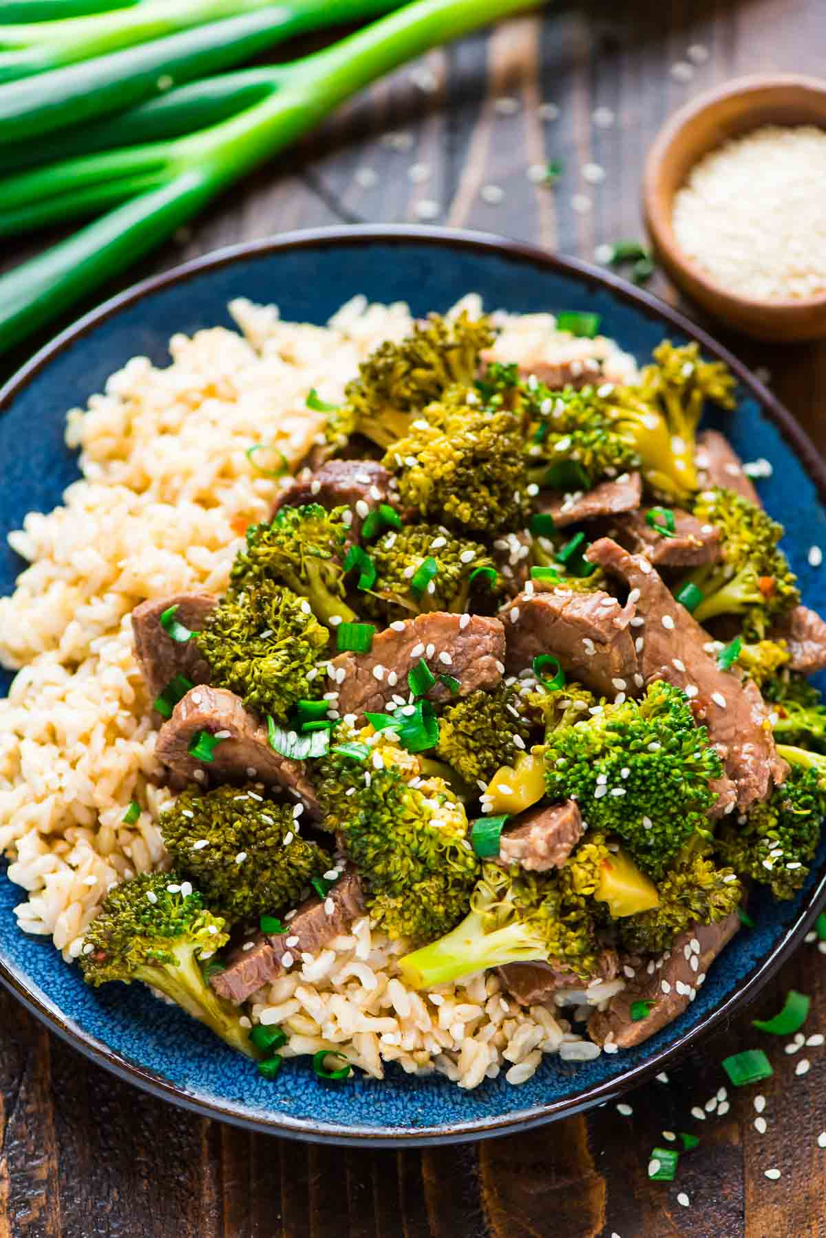 plate of slow cooker beef and broccoli served over rice