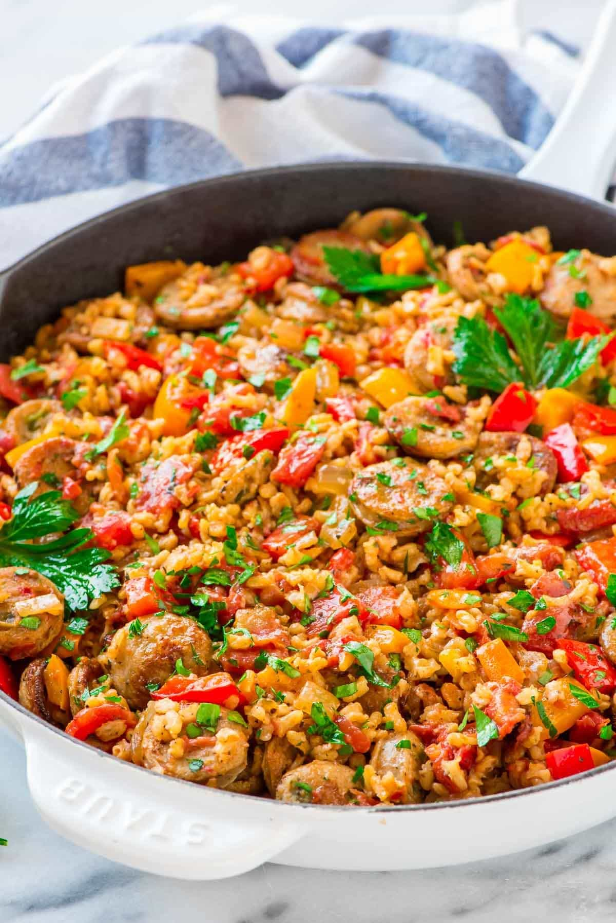 Italian Sausage and Rice Casserole with Peppers. Everyhting cooks in ONE PAN, even the rice! Quick, easy, and healthy. Recipe at wellplated.com | @wellplated
