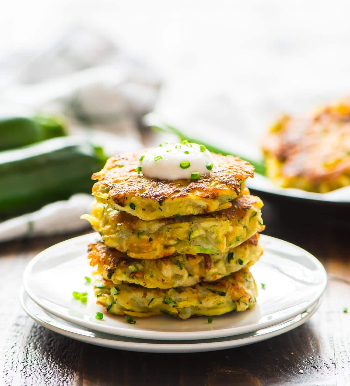 Cheese Zucchini Potato Fritters. Quick, easy, and delicious! Even picky eaters will love eating their veggies. Recipe at wellplated.com | @wellplated Zucchini Potato and Cheese Fritters. Simple and delicious! Recipe at wellplated.com | @wellplated