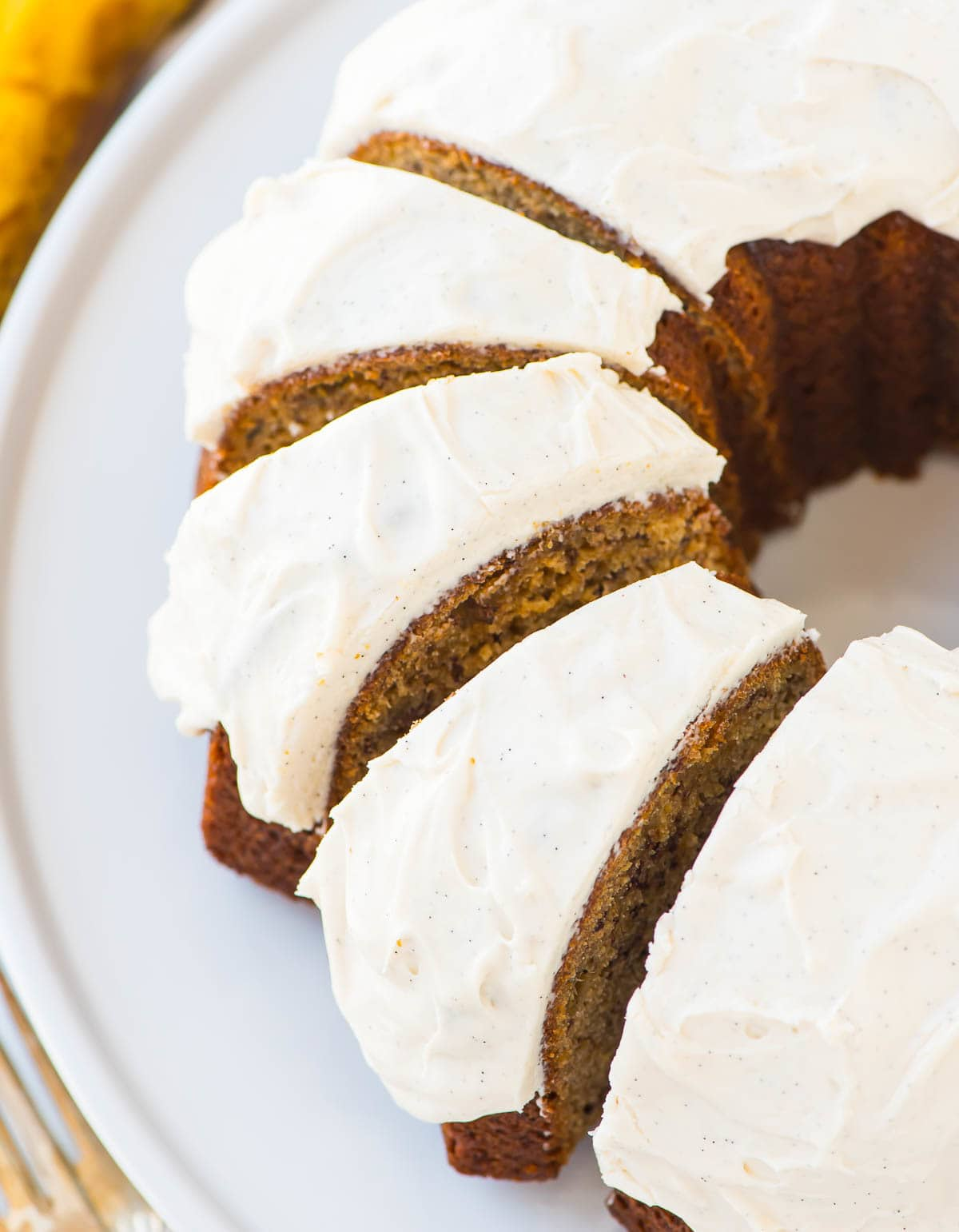The BEST Banana Bundt Cake. Moist and flavorful with vanilla cream cheese frosting. Recipe at wellplated.com | @wellplated