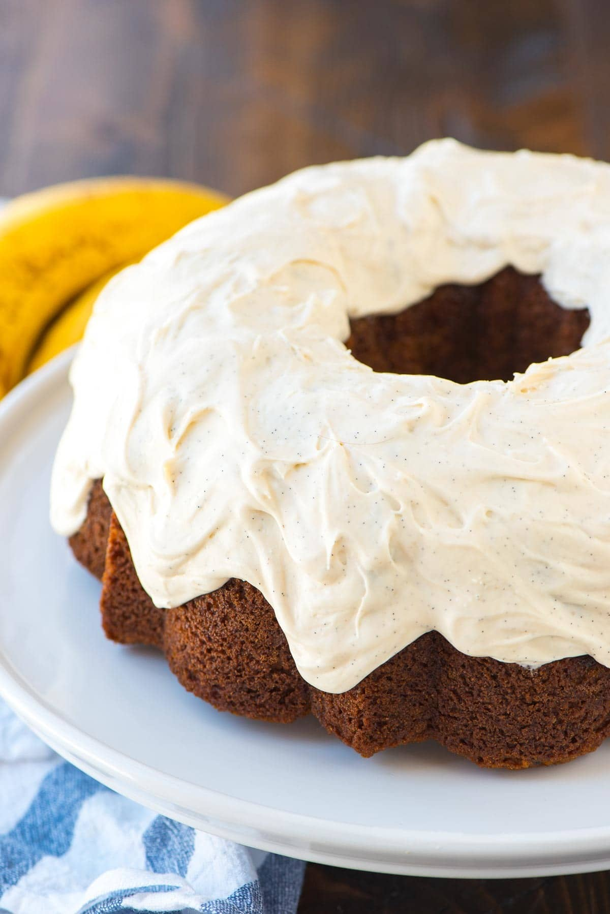 The BEST Banana Bundt Cake. Easy, moist and a MUST if you have overripe bananas. The vanilla cream cheese frosting puts it over the top! Recipe at wellplated.com | @wellplated