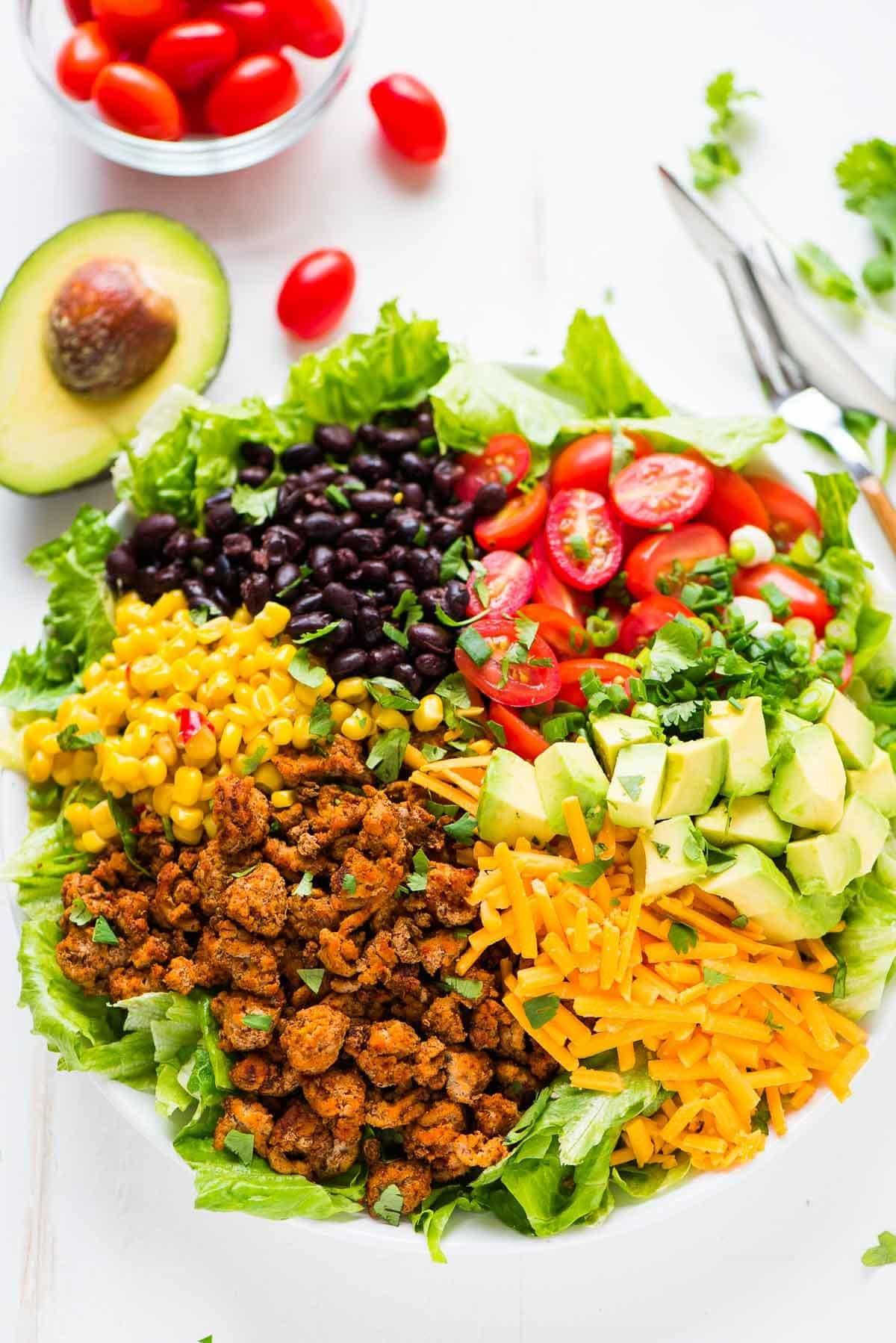 Easy Skinny Taco Salad with ground turkey, black beans, cheese, and crunchy baked tortillas. Recipe at wellplated.com | @wellplated