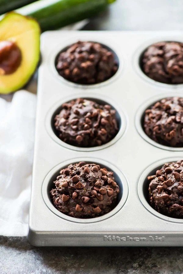 Avocado Chocolate Zucchini Muffins. Moist, healthy muffins studded with chocolate chips and made with whole wheat flour, coconut oil, and a secret serving of veggies. Toddler approved! Recipe at wellplated.com | @wellplated