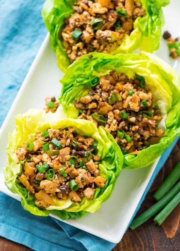 copycat PF Changs vegetarian lettuce wraps sit on a white rectangular serving platter