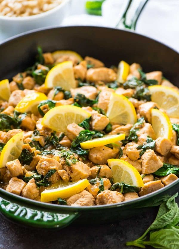 cast iron skillet with healthy lemon chicken with basil and spinach