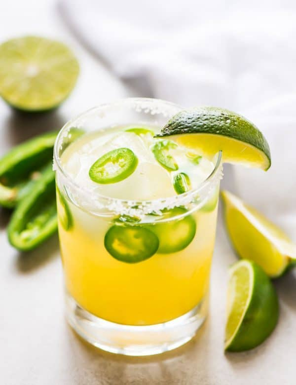cocktail glass with a spicy jalapeno margarita