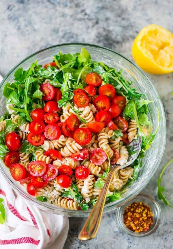 Easy, CREAMY Goat Cheese Pasta Salad with Arugula and Tomato. Ready in 15 minutes! Fast, fresh, and perfect for a picnic side dish, barbecues, and light summer meals. Recipe at wellplated.com | @wellplated