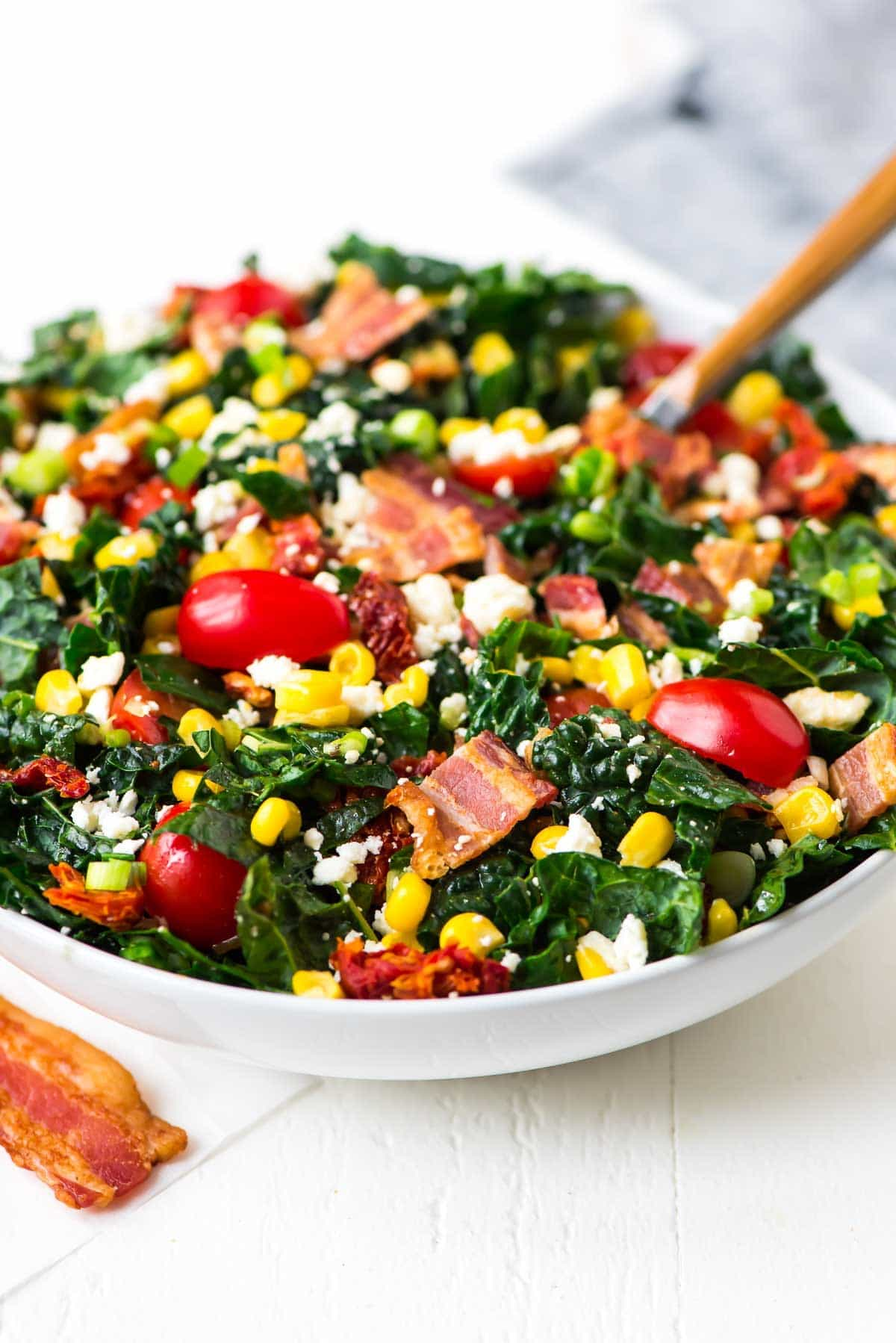 BLT Chopped Salad with feta and sweet corn. The perfect salad for summer! Can be prepped in advance and tastes great at room temperature, so it's great for meal planning, and as a picnic, potluck, or barbecue side dish. Recipe at wellplated.com | @wellplated