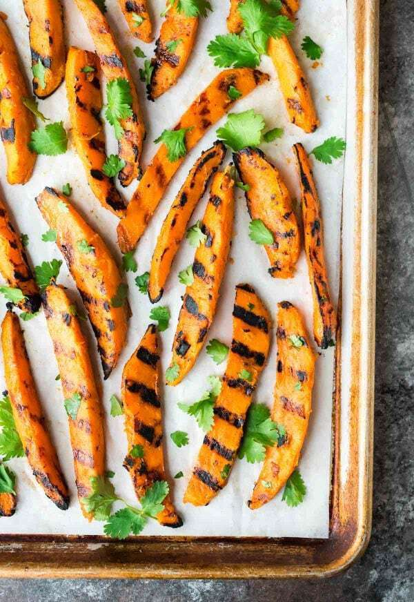 Sweet and spicy Grilled Sweet Potato Fries. The best, easiest way to make potato wedges on the grill. A healthy, gluten free side dish perfect for summer dinners! Recipe at wellplated.com | @wellplated