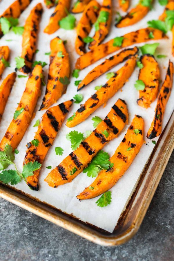 Sweet and spicy Grilled Sweet Potato Fries. An easy, healthy recipe perfect for summer grilling! Recipe at wellplated.com | @wellplated