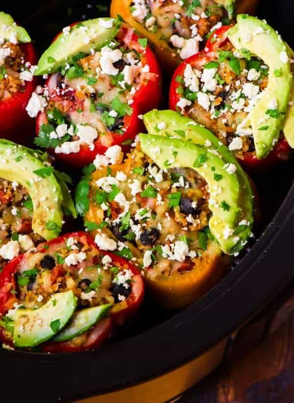healthy stuffed peppers stuffed with ground chicken, black beans, and quinoa