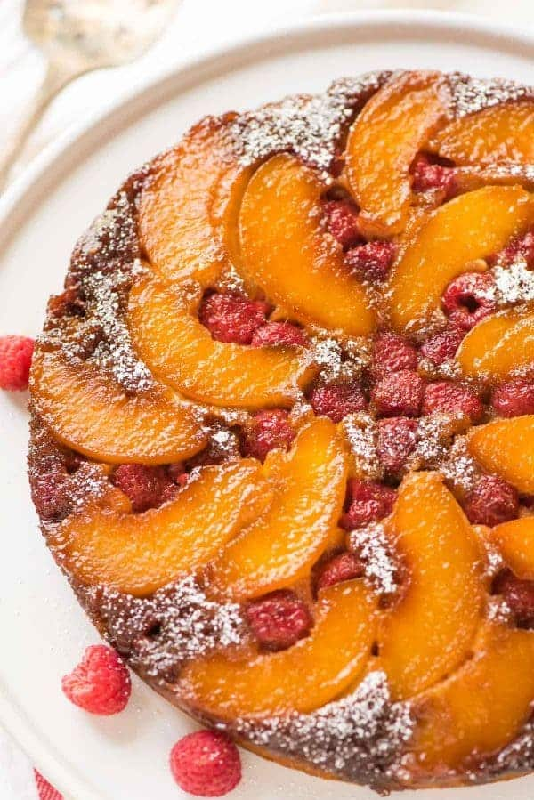 Easy Peach Upside Down Cake from scratch! Unbelievably moist with a delicious caramel topping that cooks right in the pan. Healthy, from-scratch recipe that works with fresh or frozen peaches. Recipe at wellplated.com | @wellplated