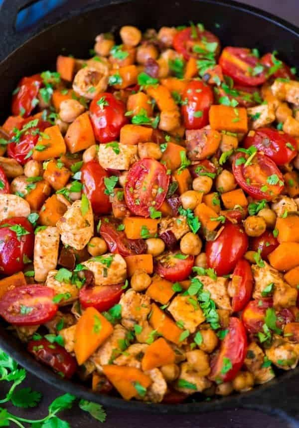 Easy Chipotle Chicken Skillet with Sweet Potatoes, Tomatoes, and Chickpeas. FLAVOR PACKED, healthy meal that's high protein and high fiber! Recipe at wellplated.com | @wellplated