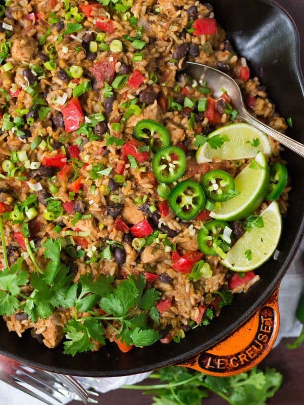 One Pot Mexican Chicken and Rice with beans and cheese. Easy, healthy recipe that's perfect for busy families and weeknight dinners. Gluten free. Recipe at wellplated.com