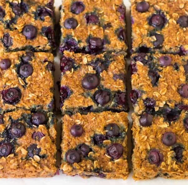 Healthy Blueberry Quinoa Breakfast Bars. Loaded with fresh blueberries, oatmeal, almond butter, and maple syrup, this easy recipe contains NO OIL and NO BUTTER and is perfect on-the-go breakfast or snack for busy mornings. Recipe at wellplated.com | @wellplated